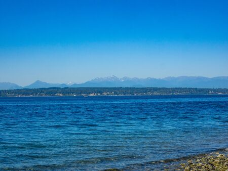 Richmond Beach Saltwater Park is beachfront park featuring walking trails, picnic shelters & a playground with Puget Sound views. Banco de Imagens
