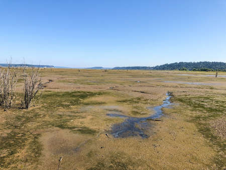 Nisqually Reach Aquatic Reserve, which includes the state-owned aquatic lands on the mainland including Nisqually River delta, and the state-owned bedlands and beaches surrounding Anderson Island, Ketron Island and Eagle Island.