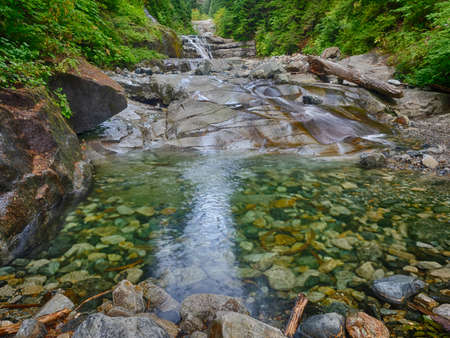 The Denny Creek Trail is extremely popular and for good reason!. A natural waterslide, two good sized waterfalls, lots of old growth forest mixed in with open areas with great views, and beautiful Alpine Lakes.