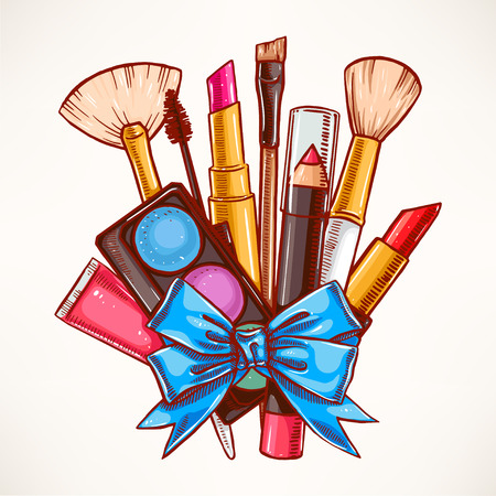 cosmetics collection: bunch of decorative cosmetics tied with blue ribbon