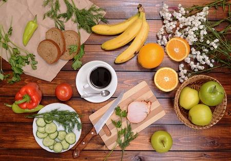 obst und gem�se: fruit vegetables and other foods of coffee on the wooden table Lizenzfreie Bilder