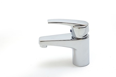 tap: Metal faucet photographed on a light background