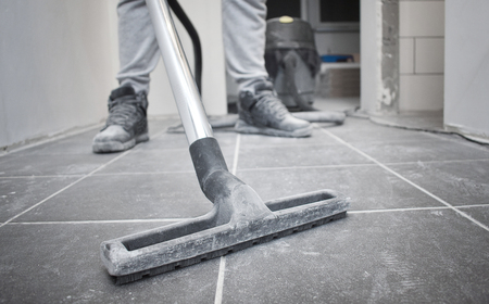 After builders cleaning with vacuum cleaner and copy space