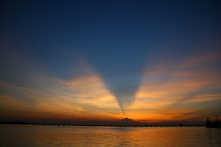 sihlouette: Sunset with wing shape cloud - sihlouette