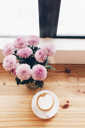 simple life: Simple necessities of life. Coffee and flowers. Stock Photo