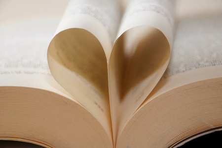 Love books.book pages in the shape of a heart. I like to read, reading. Stock Photo