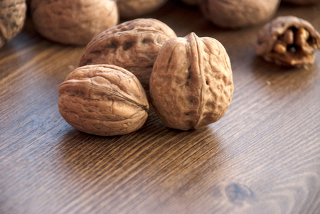 small group of objects: walnuts on the wooden-table.walnuts, wooden Background, Cracked, Small Group of Objects, Horizontal