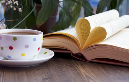 Love books and coffe on the table.
