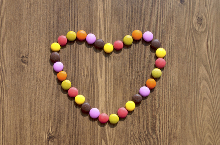 Heart made of colorful candies Standard-Bild