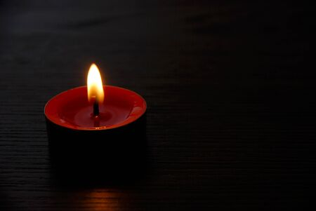 Red candle burning. Red candle burning on black background