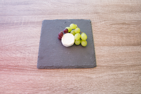 cheeseboard: Cheese board with grapes Stock Photo