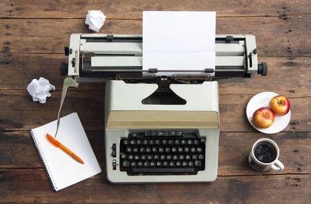 Vintage typewriter with a sheet of paper on an old desk. Writer Workplace 스톡 콘텐츠