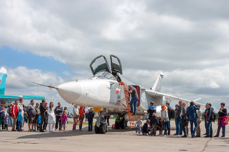 NOVOSIBIRSK, RUSSIA - JUNE 30, 2019: International military-technical Forum ARMY-2019. Civilians stand in line to get into the cockpit of a military aircraft Редакционное