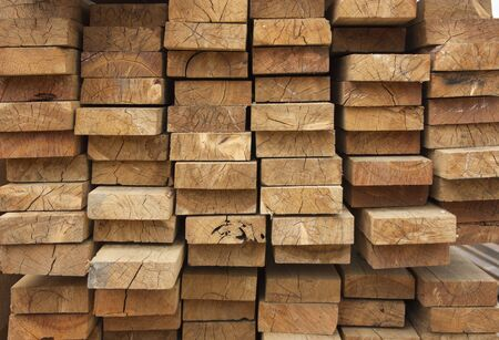 Lumber warehouse. Wooden boards are stacked. Wood texture, background