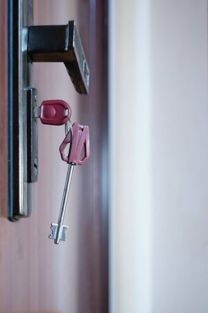 Key in the keyhole. Security guarantee concept. Close-up