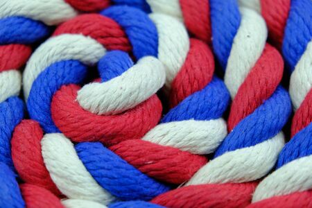 Colored bright rope twisted in a spiral for background Banque d'images