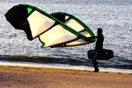 backlight kitesurfing on the beach at sunset in Sabon Atlantic Beach