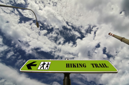 trail sign: hiking trail sign with chimney and lamppost with bue sky and clouds