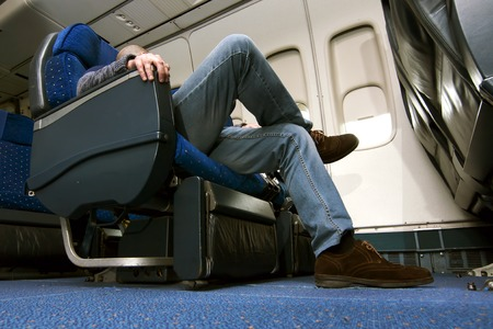 passenger  on airplane Standard-Bild