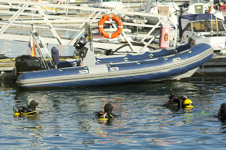 skindiver: divers at sea surface at diving course with Inflatable boat Stock Photo
