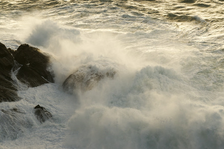 agitated: waves breaking on the cliffs on a stormy day in Corunna Spain