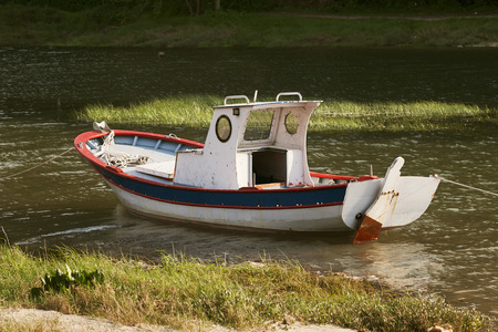 moored: old boats moored on the river bank