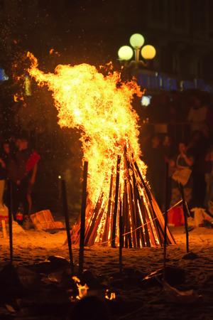 bonfires: people around bonfires on the night of Saint  John  in Coruna  Spain