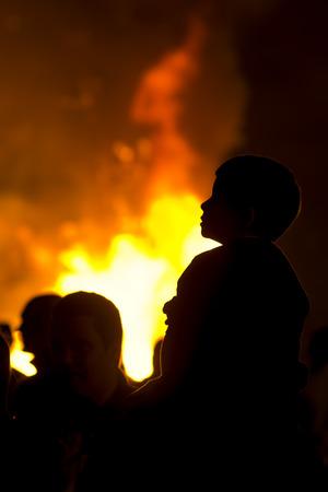 fiestas: family watching the fire from a fire on the night of Saint  John  Hogueras de San Juan    in Coruna  Spain Stock Photo