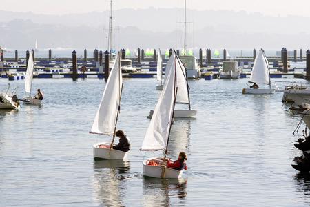 optimist: children learn to sail on optimist sailboat in Galicia Spain Stock Photo