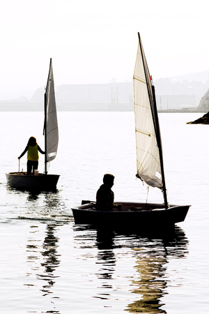 optimist: children learn to sail on optimist sailboat in Galicia Spain Stock Photo