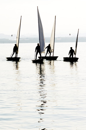 optimist: children learn to sail on optimist and 4.70 sailboats