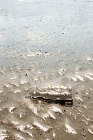 pollute: plastic bottle pollute the beach Stock Photo