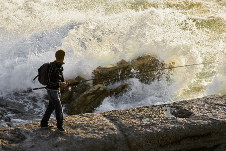 big waves: fishermen on the coast with big waves in Corunna Spain Stock Photo