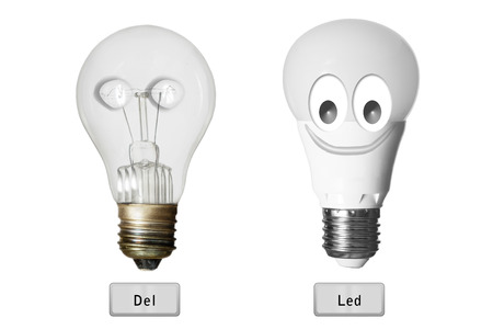 incandescence: led bulb child  versus incandescence bulb calavera huimoristic  isolated with clipping path Stock Photo