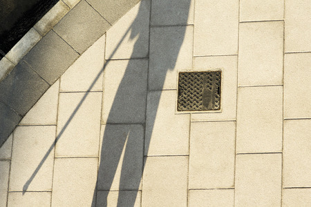 mine site: shadow in new tiles placed on the street sidewalk of the city for construction workers Stock Photo