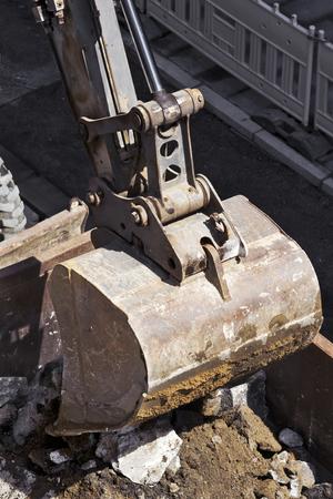 picks: bulldozer excavator machine industry picks up debris on city street