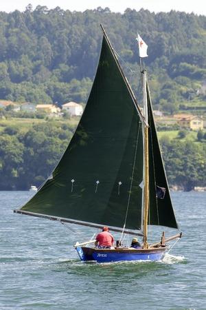 Redes Village , Galicia, Spain ,  21 julio 2012 . Traditional sailing  boats racing regatta in bays of Ares and Betanzos  in La Coruna province