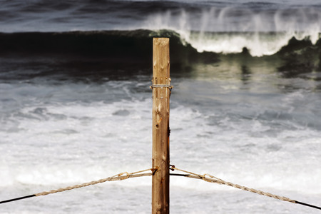 rough sea: voltage pole and rough sea  power  pressure and tension