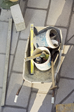 vibroroller: wheelbarrow with tools for the repair of city sidewalks