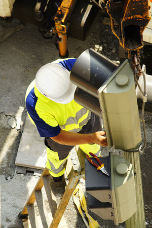 linemen: worker of utility company electrician to repair traffic lights in the city street