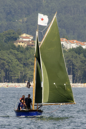 Networks Village, Galicia, Spain. 21,072,012. Traditional sailing regatta racing boats Editorial