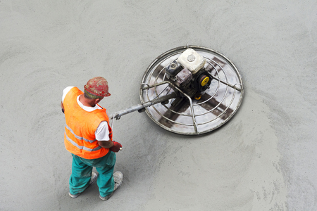 vibration machine: asphalt construction worker to repairing road with compactor manual plate in street city
