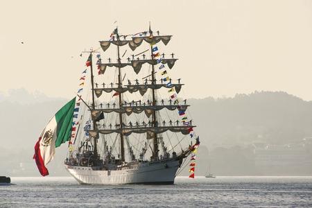 Tall Ships races August 10 , 2012 in Coruna , Spain ; Cuauhtemoc  sail training ship , Mexico , and San Anton Castle Editorial