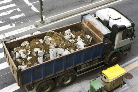 truckload: truckload of debris in the  city  street