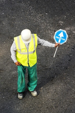 road signal: construction mason worker with precaution in road signal street of city