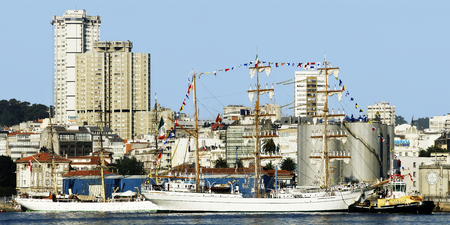Tall Ships races August 8 , 2012 in Coruna , Spain ; Cuauhtemoc  sail training ship , Mexico , and San Anton Castle
