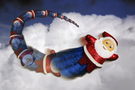 weihnachtsmann: Santa Claus superhero flying in the sky