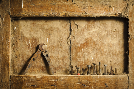 mano anziano: old  hand tools on a antique wooden panel  background still life