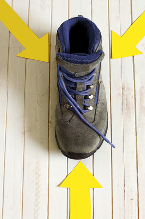 way of st  james: Way of St. James pilgrim boot with yellow arrow mark to Compostela Cathedral, Spain. Santiagos road