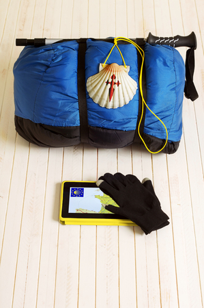 way of st  james: Pilgrim shell, sleeping bag and tablet for Way of St James to Compostela Cathedral, Spain. Santiagos road